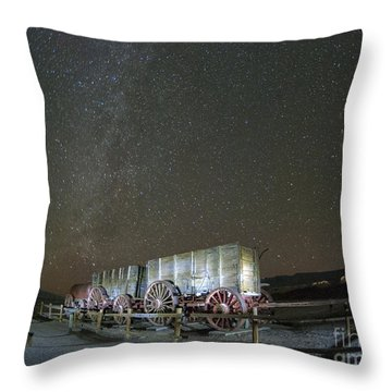 Wagon Train Under Night Sky Throw Pillow