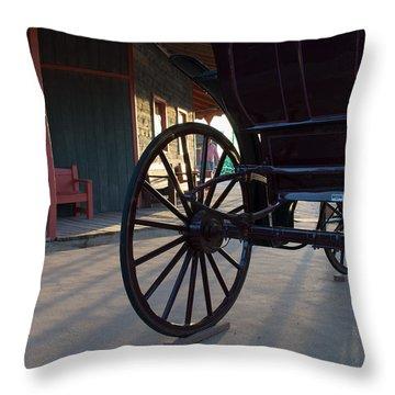 Throw Pillow featuring the photograph Wagon Wheel Time by Carolina Liechtenstein
