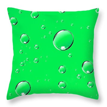 Water Drops On Green Throw Pillow by Sharon Dominick