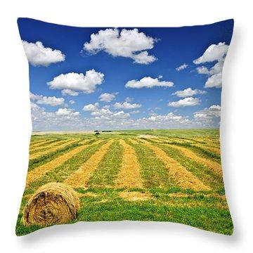 Wheat Farm Field And Hay Bales At Harvest In Saskatchewan Throw Pillow by Elena Elisseeva