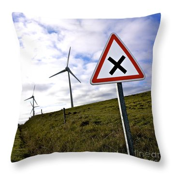 Wind Turbines On The Edge Of A Field With A Road Sign In Foreground. Throw Pillow by Bernard Jaubert