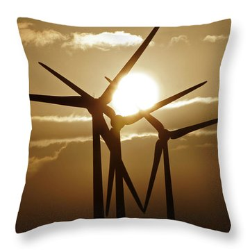 Wind Turbines Silhouette Against A Sunset Throw Pillow