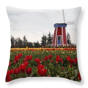 Windmill Red Tulips Throw Pillow by Athena Mckinzie