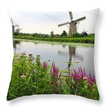 Windmills Of Kinderdijk With Wildflowers Throw Pillow by Carol Groenen