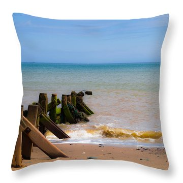 Withernsea Groynes Throw Pillow by Scott Lyons