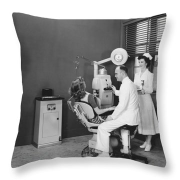 Woman In A Dentist�s Office Throw Pillow