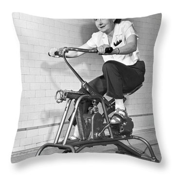 Woman On Exercycle Throw Pillow by Underwood Archives