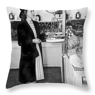 Woman Weighing Vegetables Throw Pillow by Underwood Archives