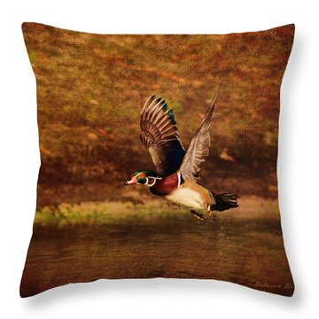 Wood Duck Taking Off Throw Pillow by Deborah Benoit