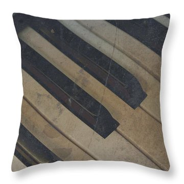 Throw Pillow featuring the photograph Worn Out Keys by Photographic Arts And Design Studio
