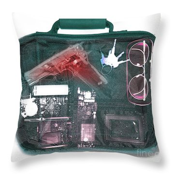 X-ray Of A Briefcase With A Gun Throw Pillow by Scott Camazine