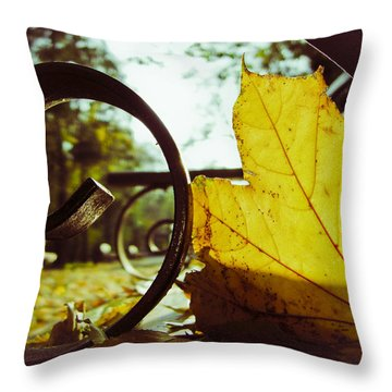 Yellow Leaf On A Bench In A Park Throw Pillow