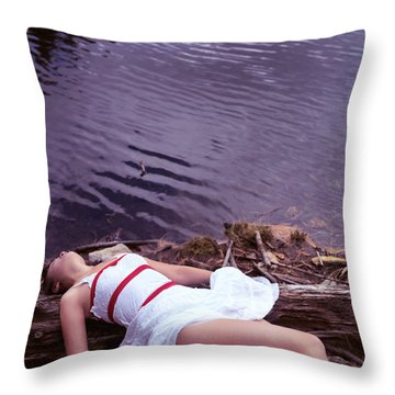Young Woman In Dress And Bondage Rope Lying Near Water Throw Pillow