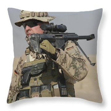 A German Soldier Carries A Barrett Throw Pillow by Terry Moore