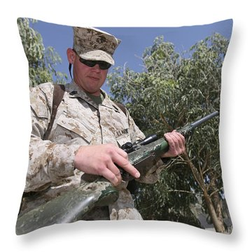 A Soldier Holds The M-40a1 Sniper Rifle Throw Pillow by Stocktrek Images