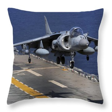 An Av-8b Harrier Jet Lands Throw Pillow by Stocktrek Images