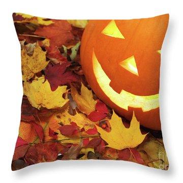 Carved Pumpkin On Fallen Leaves Throw Pillow by Oleksiy Maksymenko