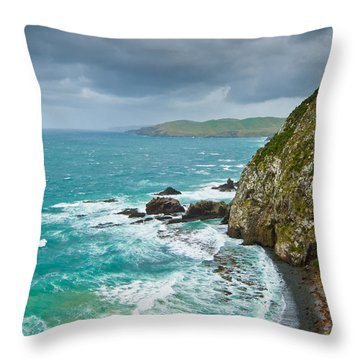 Cliffs Under Thunder Clouds And Turquoise Ocean Throw Pillow by Ulrich Schade