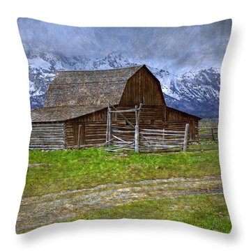Grand Teton Iconic Mormon Barn Fence Spring Storm Clouds Throw Pillow by John Stephens