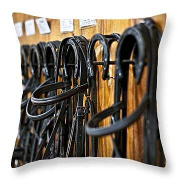 Horse Bridles Hanging In Stable Throw Pillow by Elena Elisseeva
