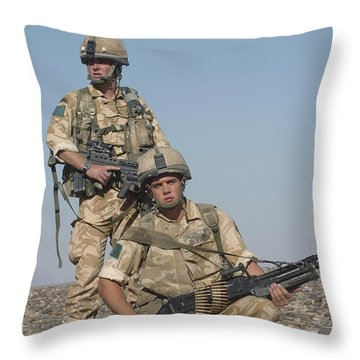 Members Of The British Army On Foot Throw Pillow by Andrew Chittock