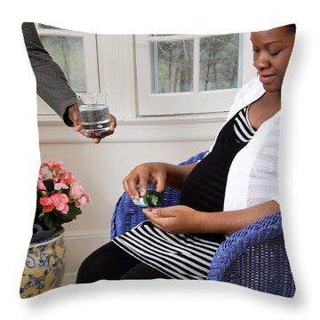 Pregnant Woman Taking Vitamins Throw Pillow by Photo Researchers