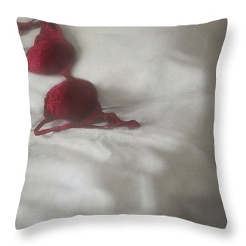 Red Brassiere Laying On Bed Throw Pillow by Sandra Cunningham