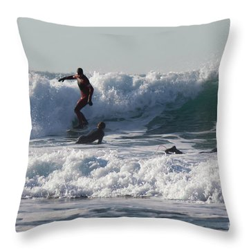 Surfers At Porthtowan Cornwall Throw Pillow by Brian Roscorla