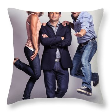 Three Fashionably Dressed Young People Throw Pillow by Oleksiy Maksymenko