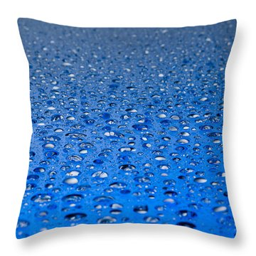 Throw Pillow featuring the photograph Water Drops On A Shiny Surface by Ulrich Schade