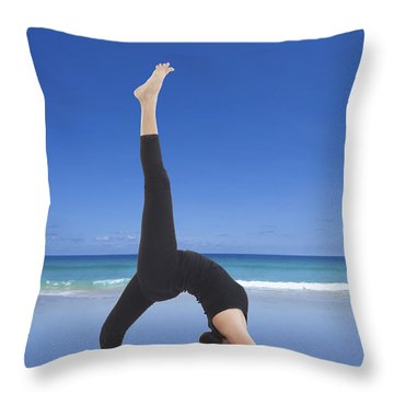 Woman Doing Yoga On The Beach Throw Pillow by Setsiri Silapasuwanchai