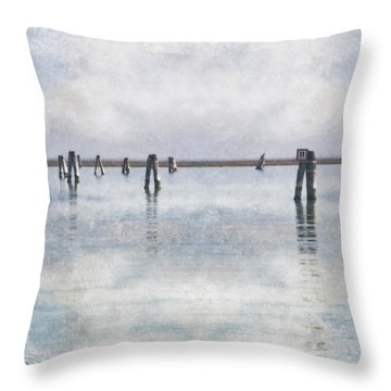 wood piles in the lagoon of Venice Throw Pillow by Joana Kruse