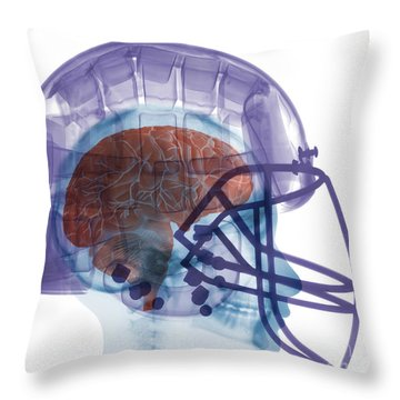 X-ray Of Head In Football Helmet Throw Pillow by Ted Kinsman