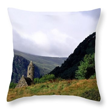 Chapel Of Saint Kevin At Glendalough Throw Pillow by The Irish Image Collection