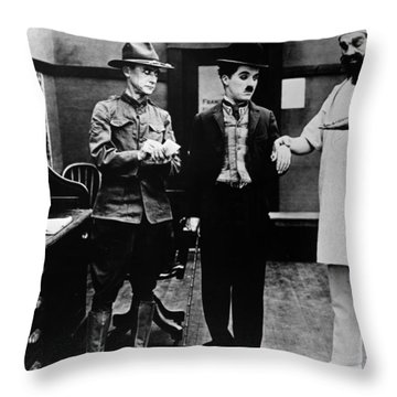 Chaplin: Shoulder Arms Throw Pillow by Granger