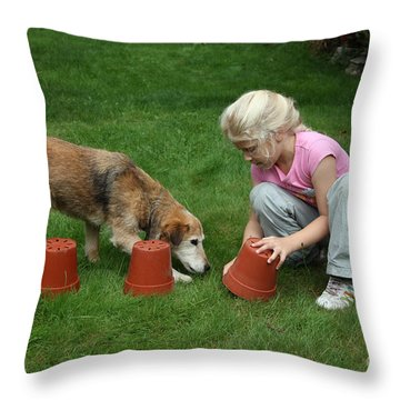 Girl Playing With Dog Throw Pillow by Mark Taylor