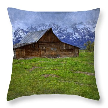 Grand Teton Iconic Mormon Barn Spring Storm Clouds Throw Pillow by John Stephens