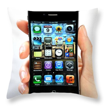 Hand Holding An Iphone Throw Pillow by Photo Researchers