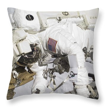 An Astronaut Participates In A Session Throw Pillow by Stocktrek Images