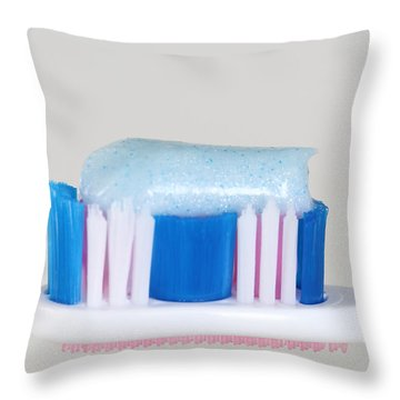 Toothpaste Throw Pillow by Photo Researchers, Inc.