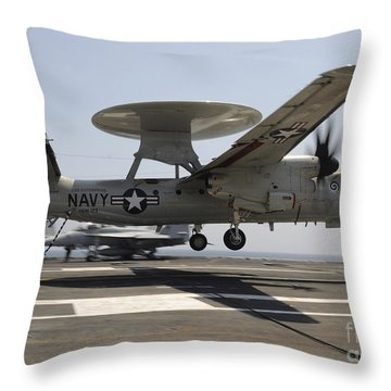 An E-2c Hawkeye Lands Aboard Throw Pillow by Stocktrek Images
