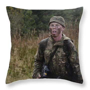 A British Soldier During Exercise Throw Pillow by Andrew Chittock