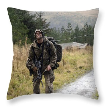 A British Soldier With Radio Throw Pillow by Andrew Chittock