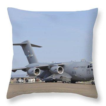 A C-17 Globemaster IIi Parked Throw Pillow by Stocktrek Images