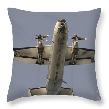 A C-2 Greyhound In Flight Throw Pillow by Stocktrek Images