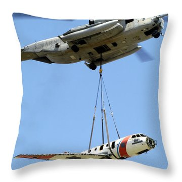 A Ch-53 Sea Stallion Lifts A Hu-25 Throw Pillow by Stocktrek Images