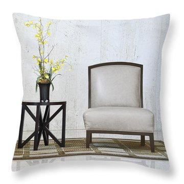 A Chair And A Table With A Plant  Throw Pillow