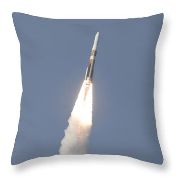 A Delta Iv Rocket Roars Into The Sky Throw Pillow by Stocktrek Images