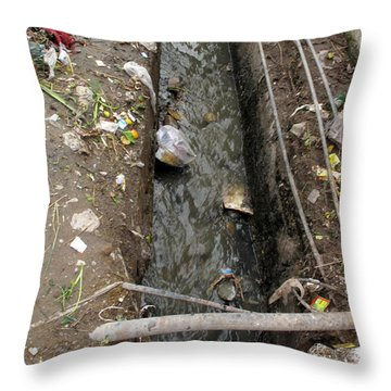 Throw Pillow featuring the photograph A Dirty Drain With Filth All Around It Representing A Health Risk by Ashish Agarwal