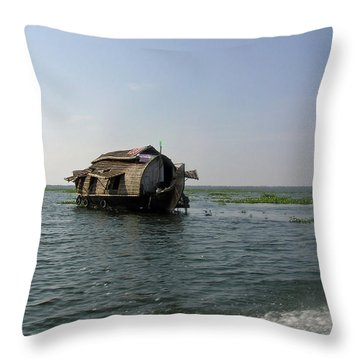 Throw Pillow featuring the photograph A Houseboat Moving Placidly Through A Coastal Lagoon In Alleppey by Ashish Agarwal